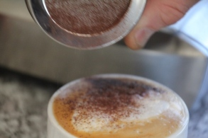 chocolate-being-sprinkled-on-capuccino