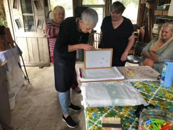 Papermaking: laying wet paper onto cloth